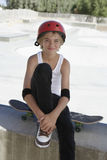 Teenage Boy With Skateboard Sitting In Skate Park Royalty Free Stock Images