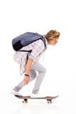 Teenage boy skateboarding Stock Images