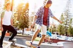 Teenage boy skateboarding outdoors Royalty Free Stock Photos