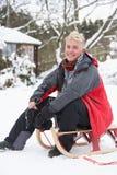 Teenage Boy With Sledge Royalty Free Stock Photos