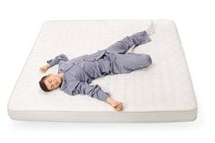 Teenage boy sleeping on a mattress Royalty Free Stock Photo