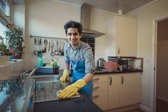 Teenager Cleaning the Kitchen royalty free stock image