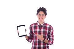 Teenage boy smiling. Smiliy frindly teenage boy  holding the tablet and pointing to it, teenager wearing red shirt,  isolated white background Royalty Free Stock Images