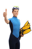 Teenage boy with snorkeling equipment making a thumb up sign Royalty Free Stock Photo