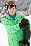 Teenage Boy With Snowboard On Ski Holiday Stock Photography