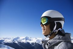 Teenage boy snowboarder in mountains. Royalty Free Stock Image