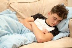 Teenage boy on a sofa Stock Photography