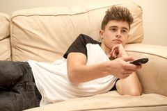 Teenage boy on a sofa Stock Photos