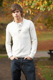 Teenage Boy Standing In Autumn Park. On footpath Stock Photos