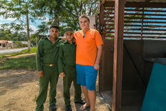 teenage boy standing with cuban soldiers Stock Photos