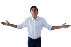 Teenage boy standing with hands raised Stock Photography