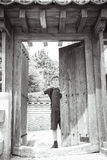Teenage boy is standing at a japanese gate Royalty Free Stock Photography