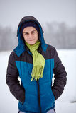 Teenage boy standing on a snowy field Stock Photos