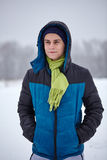 Teenage boy standing on a snowy field Royalty Free Stock Photos