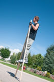Teenage boy on stilts Royalty Free Stock Photos