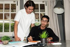Teenage Student In Classroom With Tutor. Teenage Boy Studying With Home Tutor Stock Images