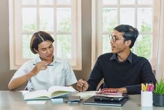 Teenage Student In Classroom With Tutor. Teenage Boy Studying With Home Tutor Stock Photography
