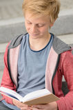 Teenage boy studying reading book Royalty Free Stock Photo