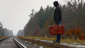 Teenage boy with a suitcase stock footage
