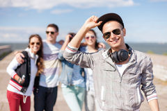 Teenage boy with sunglasses and friends outside Stock Photos