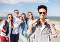 Teenage boy with sunglasses and friends outside Stock Image