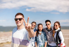 Teenage boy with sunglasses and friends outside Stock Photo
