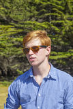 Teenage boy with sunglasses on the meadow Royalty Free Stock Photography