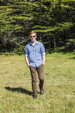 Teenage boy with sunglasses on the meadow Royalty Free Stock Photos