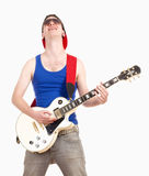 Teenage Boy with Sunglasses Playing Electric Guitar Stock Photo