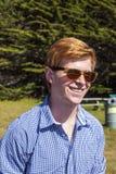 Teenage boy with sunglasses walks Royalty Free Stock Photography