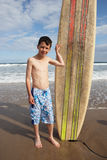 Teenage boy with surfboard Royalty Free Stock Photography