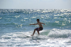 Teenage Boy Surfing Near Fort Lauderdale, Florida, United States of America Stock Photo