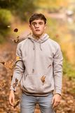 Teenage boy and falling leaves stock images