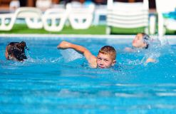 Teenage boy swimming in the pool Royalty Free Stock Photography