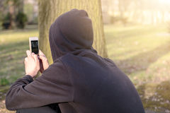 Teenage boy taking photographs. With a smart phone stock image