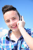 Teenage boy talking on cell. Teenage boy talking on mobile phone and smiling Stock Photography