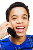 Teenage Boy Talking On Mobile Phone. Teenage boy talking on a mobile phone isolated over white Stock Images