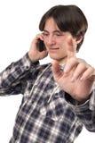 Teenage boy talking on mobile phone. Isolated on white background Royalty Free Stock Photography