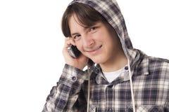 Teenage boy talking on mobile phone. Isolated on white background Royalty Free Stock Photos