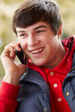 Teenage Boy Talking On Smartphone Royalty Free Stock Photos