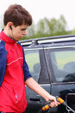 Teenage Boy Washing Car Royalty Free Stock Photography