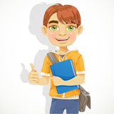 Teenage boy with a textbook Royalty Free Stock Photos