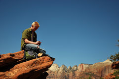 Teenage Boy Texting in Zion Stock Images