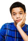 Teenage Boy Thinking. Isolated over white Royalty Free Stock Photo