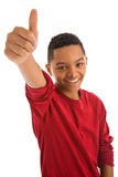 Teenage boy with thumbs up sign Stock Image