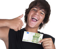 Teenage boy with a ticket of 100 euros Stock Photo