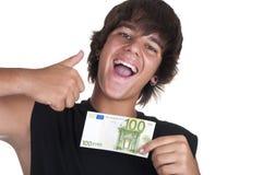 Teenage boy with a ticket of 100 euros. On white background Stock Photo