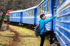 Teenage Boy Traveler. Getting into a train