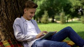 Teenage boy typing query in browser search bar, private access, parental control. Stock photo royalty free stock photo