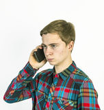 Teenage boy uses the mobile Royalty Free Stock Image